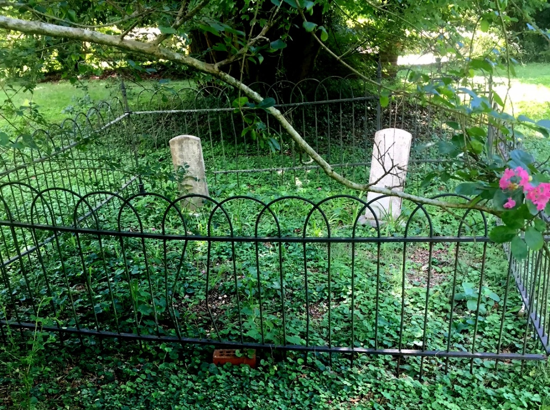 tombstones and fence